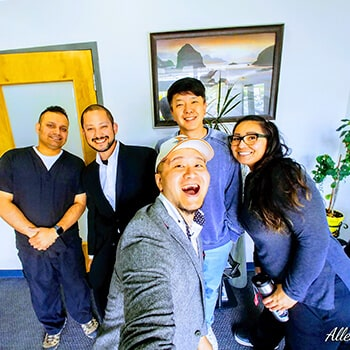 All our dental specialists smiling in the waiting room of Elegant Dentistry