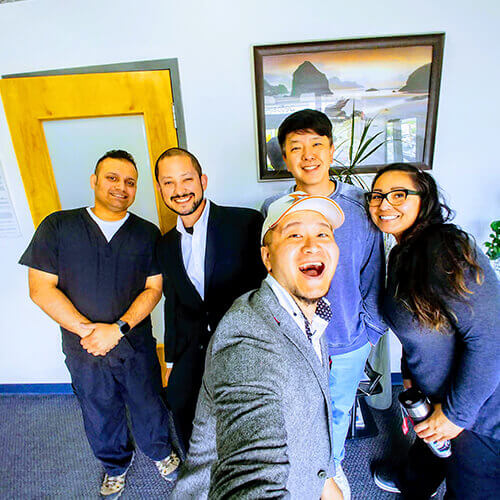 Our Elegant Dentistry team smiling in the office while taking a selfie
